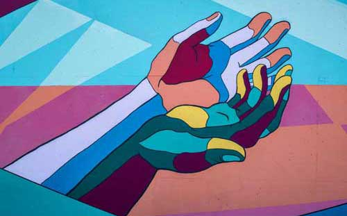 Artistic painting of hands in multi color